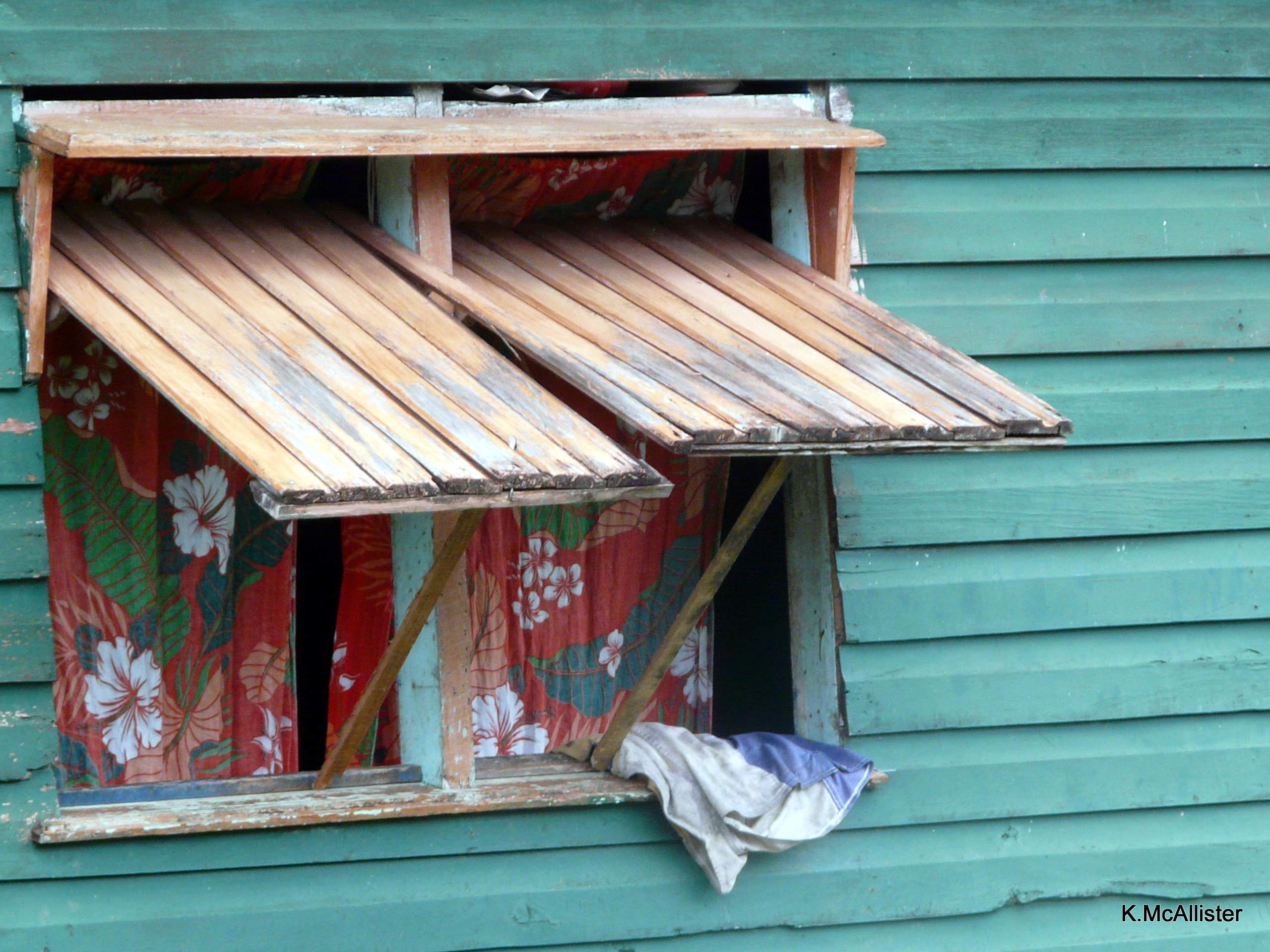 Window shutters open in a village in Savusavu, Fiji
