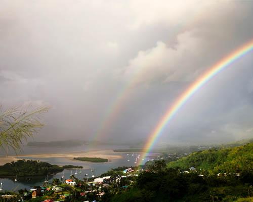 A rainbow appears above Savusavu, Fiji.